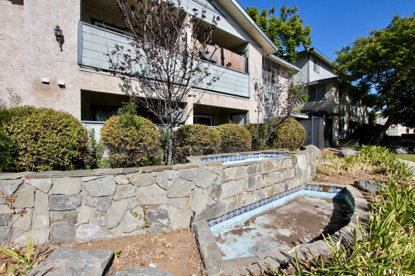 The outside ground view of Gentry Villas, Chula Vista, CA showing fountains.