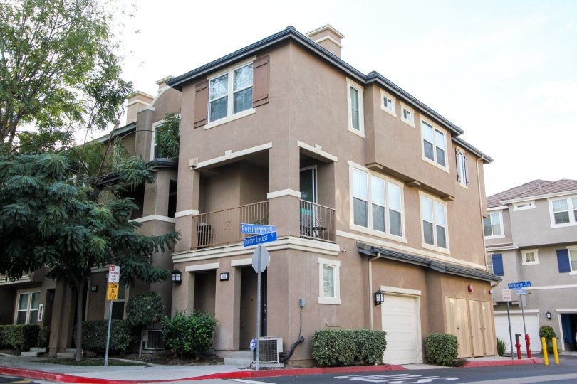 Some apartments on the corner of the street in the Greystone community in Chula Vista, California