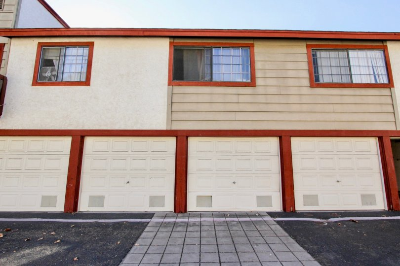 Orange accents on multi-family housing with box fan in window of the leftmost unit: Hilltop Village, Chula Vista, CA