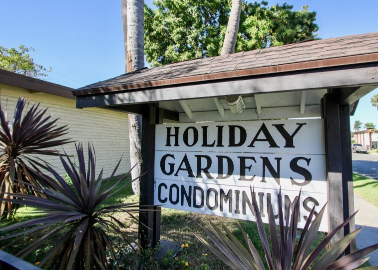 Entry sign to Holiday Gardens Condominiums in Chula Vista, CA on a clear day