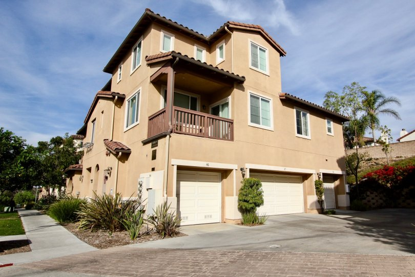 Exterior view of garages and balcony at Mar Brisa in Chula Vista, CA