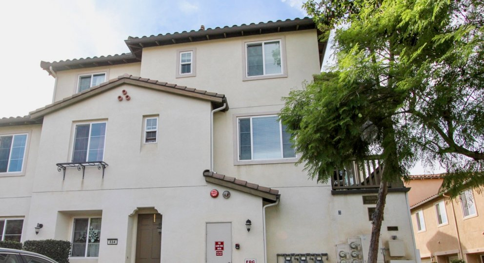A three story white town home building inside Mar Brisa located at Chula Vista CA