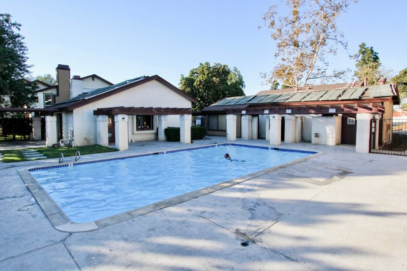 The provate swimming pool and exterior of some of the buildings at the Melrose Villas community.