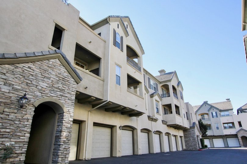 Stone entrance way to multi-unit condos at Mer Soleil with above-garage units.