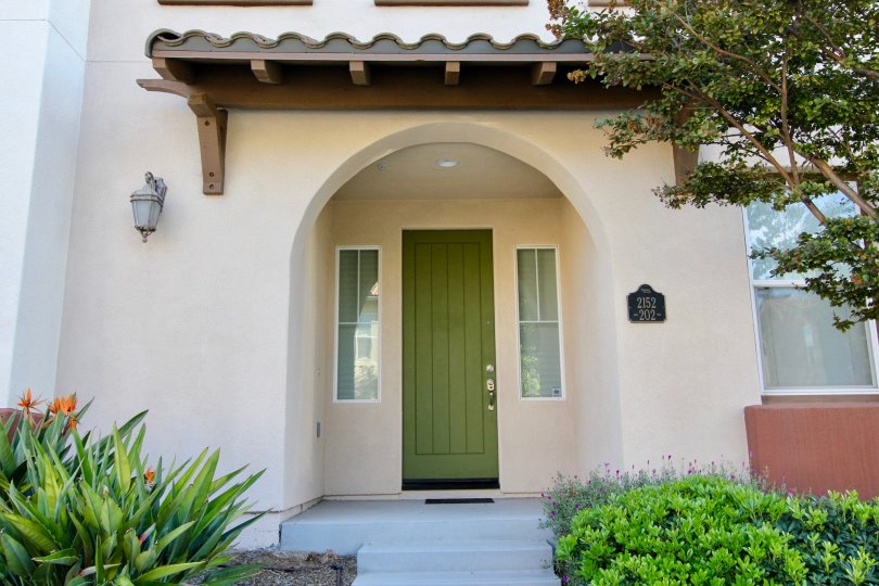 The front of the house in Saguaro with the green front door.
