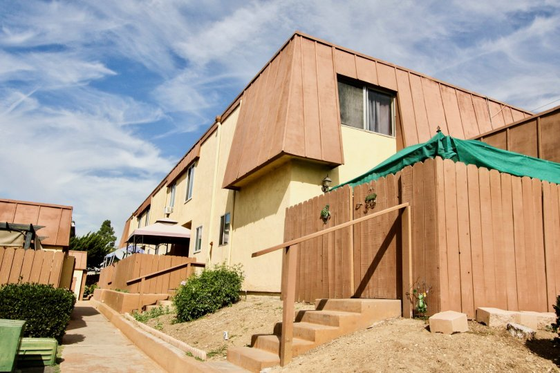 The Stonebridge II apartments with tall wood fences and minimal landcaping