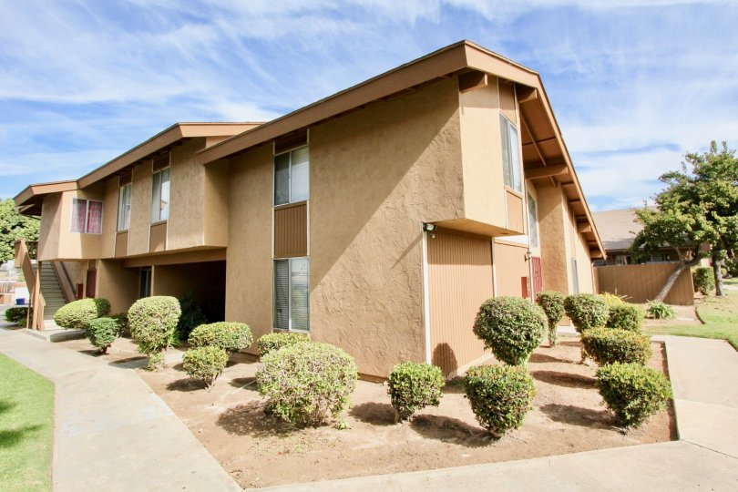 An orange housing apartment in Stonebridge, California on a sunny day.
