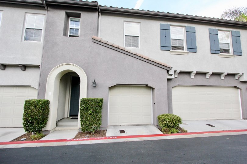 Two Garages and an entranceway of a summer hill home in Chula Vista