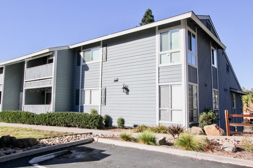 A modern townhouse unit with parking space of the Telegraph Canyon Terrace community.