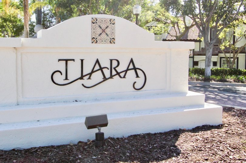 A concrete signage at the Tiara community with one decorative tile.