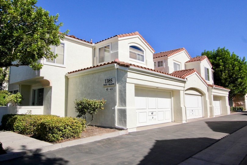 big white house with classic work and plenty of garage space and a nice surrounding