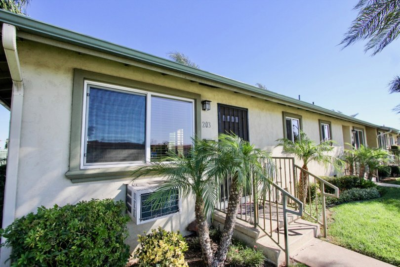 THE HOUSE NUMBER 243 IN THE TWIN OAKS WITH THE STEPS, AIR CONDITIONER, GRASS, PLANTS