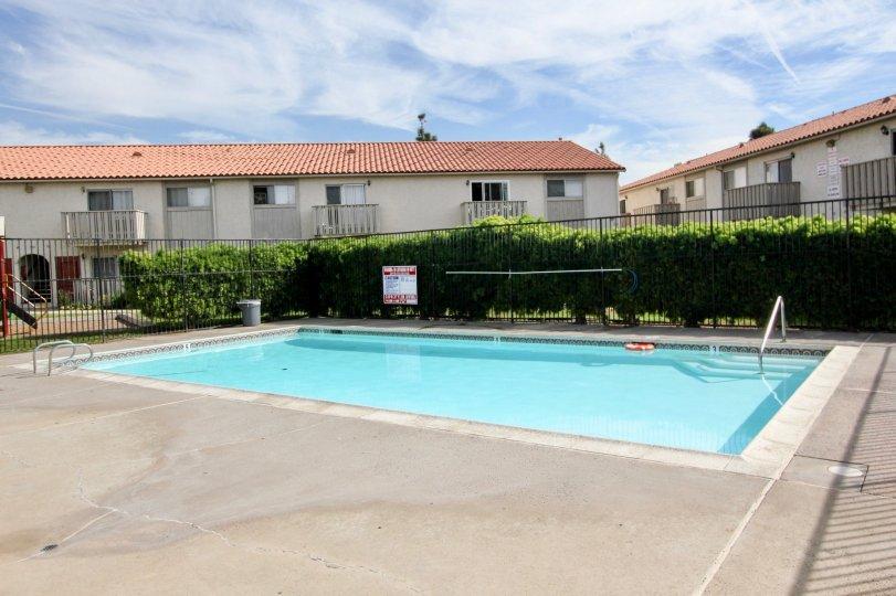 Swimming pool with wide area and railing in Villa De Anita.