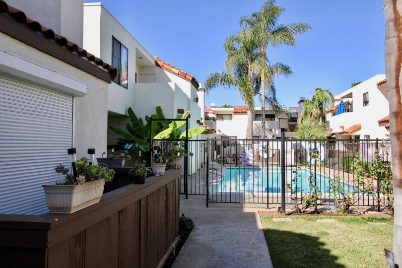 Two-storey residences in the Villa Hermosa community with gated pool.