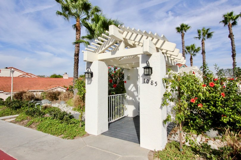Entryway to #1085 in Villa Palmera with foliage and lighting in Chula Vista, CA