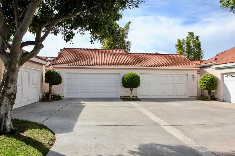 A sunny day in the Villa Palmera area of Chula Vista with a series of white garage doors.