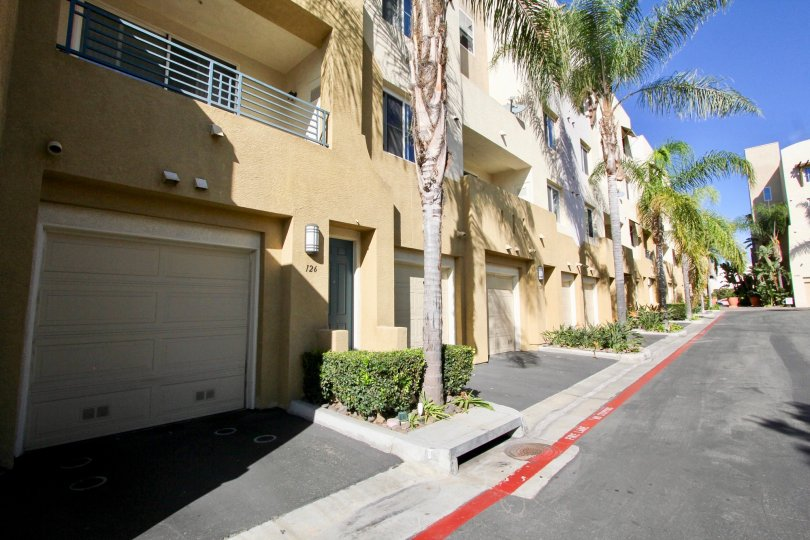Driveway and garages to apartments at Vellagio with palm trees in Chula Vista, Ca.