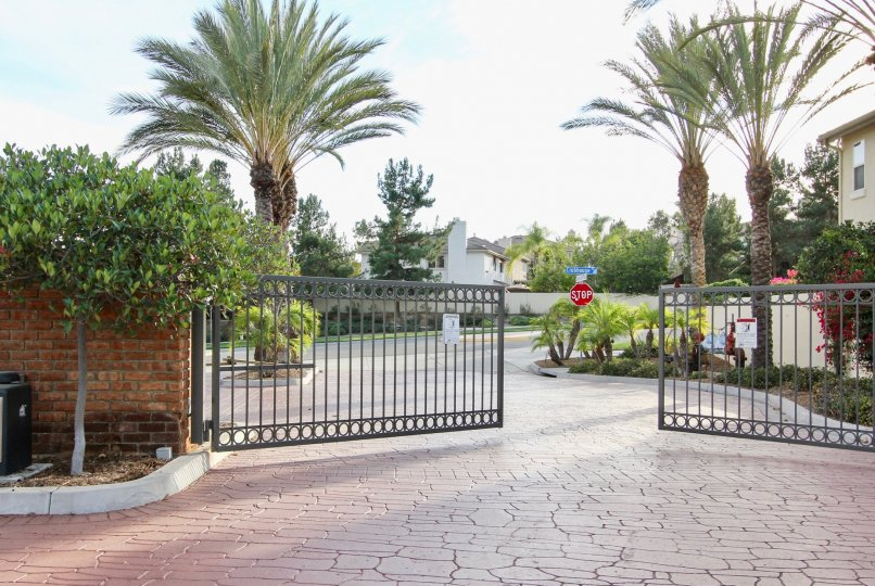 A gated entryway to the Willow Bend community with a well-paved road.