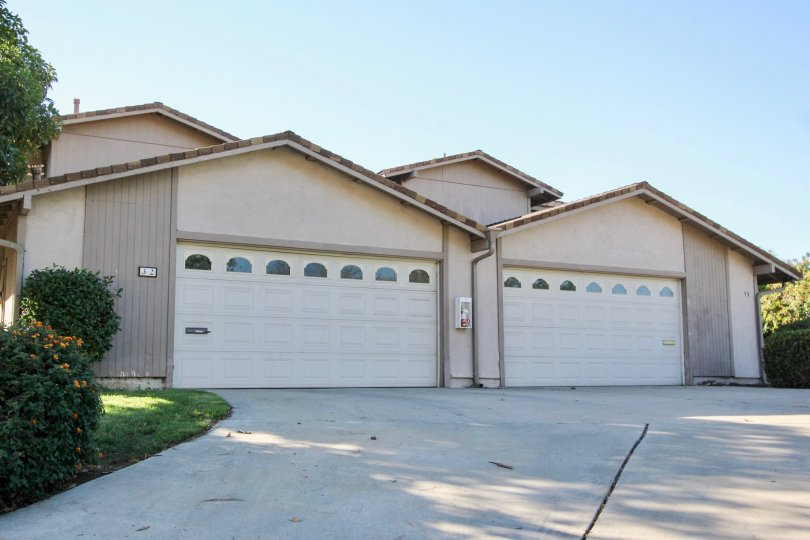 A house located in Windsor Heights community in Chula Vista, California. Has two garage doors and shows the driveway.