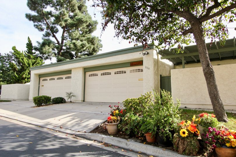 A cream and green double garage in the Windsor View community