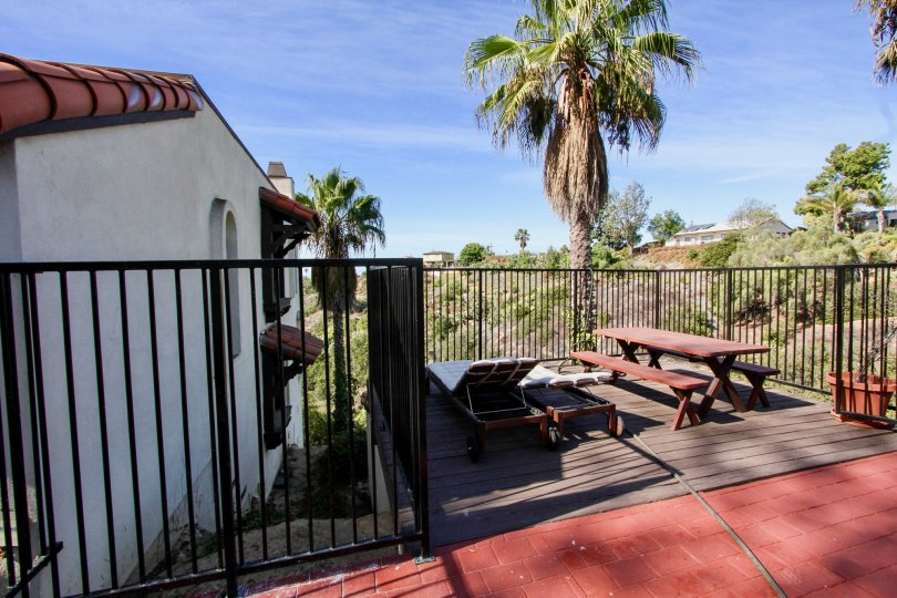 Bay Vista Community Clairemont Mesa California palm tree picnic tables lounge chairs fence patio balcony landscaping tile roof arched windows Spanish style