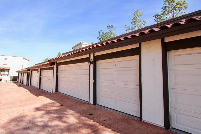 Driveway lined with parking garages at Bay Vista in Clairemont Mesa California