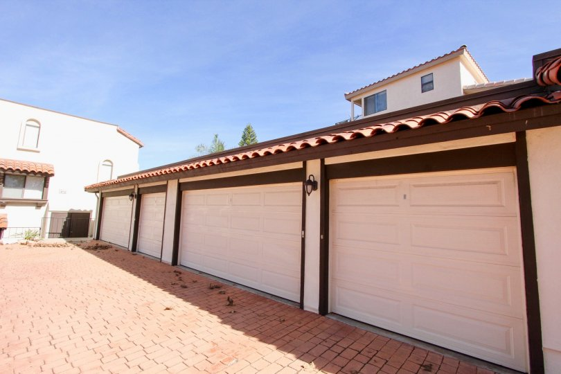 Cream colored garages with brown detailing in Bay Vista in Clairemont Mesa, California.