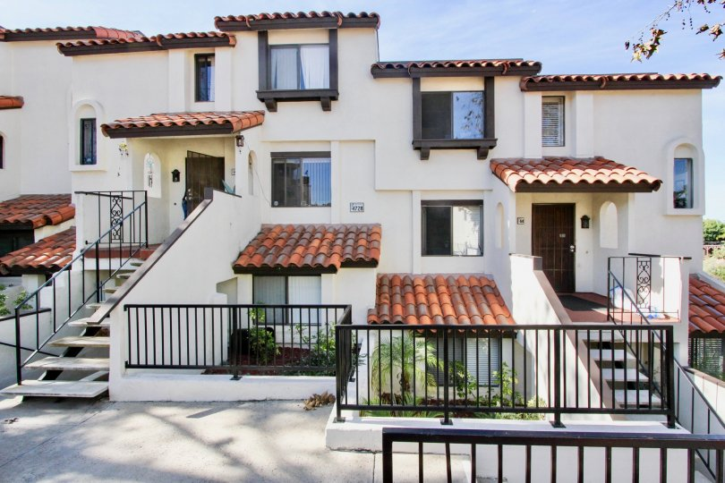 Three story residential building with black iron gates at Bay Vista in Clairemont Mesa California