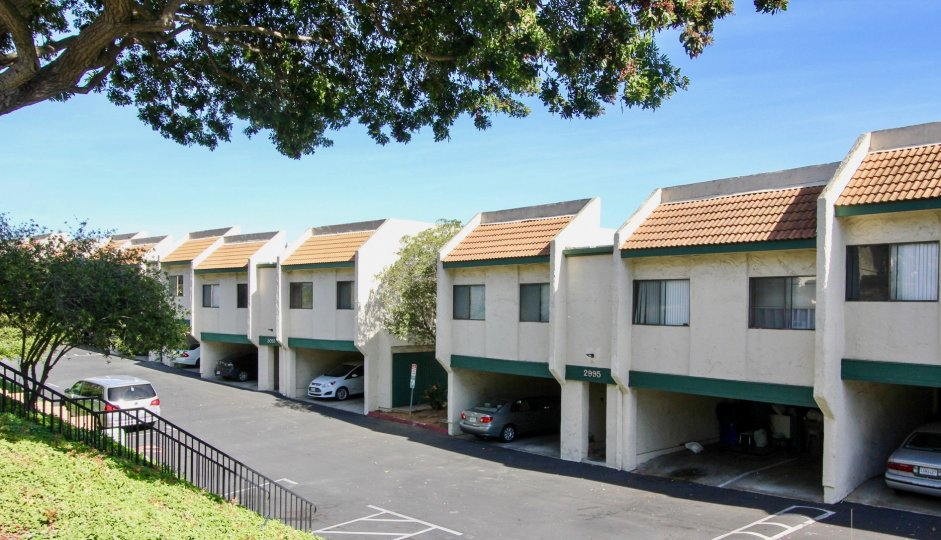 Multiple off white units with covered parking located in Forest Park Plaza of Clairemont Mesa, California