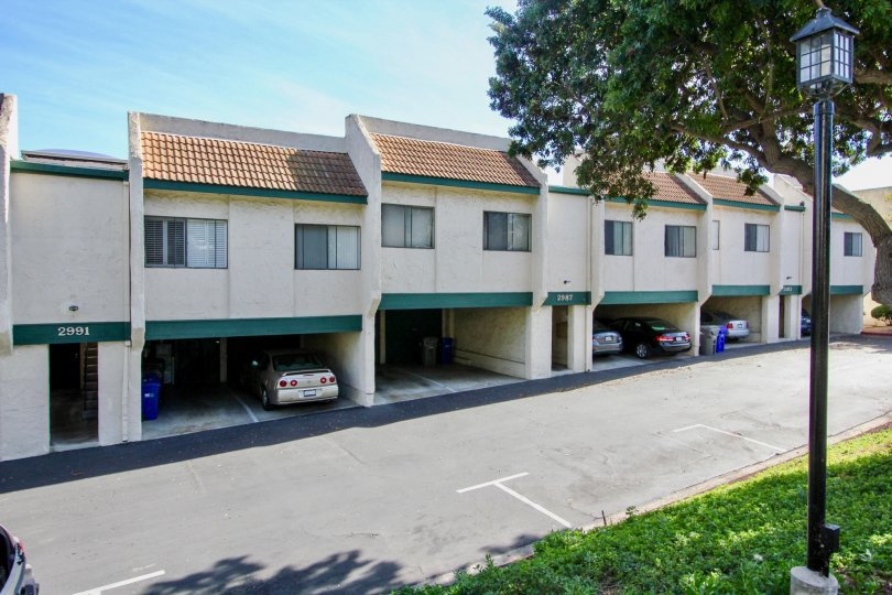 Driveway along side of parking area and residential buildings at forest park plaza in Clairemont Mesa California