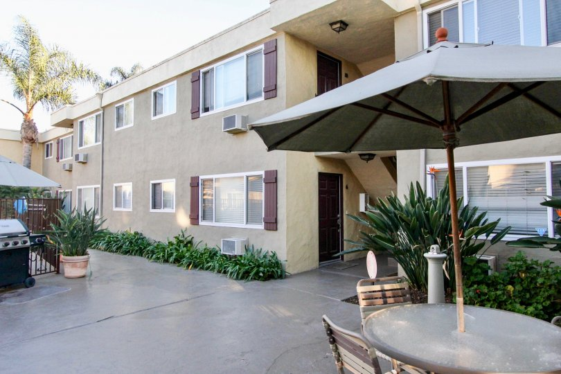 Courtyard view with bbq grill, outdoor patio and view of apartments in Heritage Park East located in Clairemont Mesa California