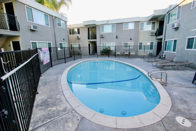 THE APARTMENT IN THE HERITAGE PARK WEST WITH THE SWIMMING POOL, STEEL GATE, GLASS WINDOW, CHAIRS