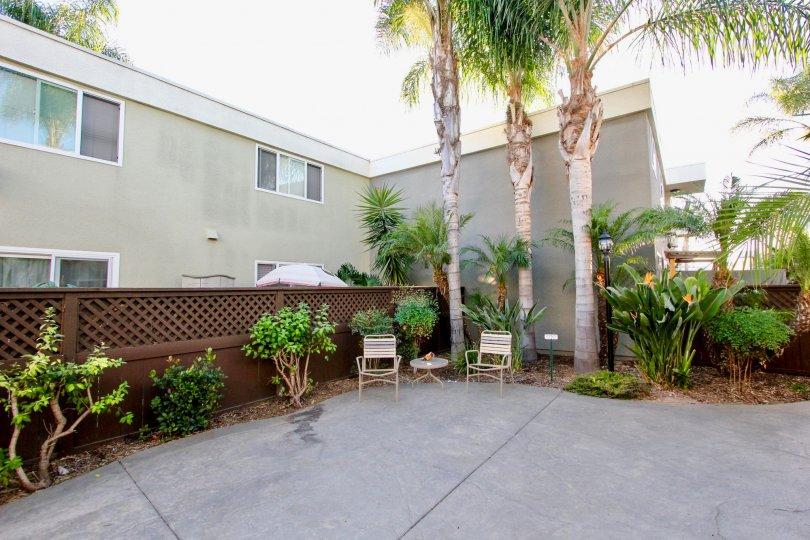 Heritage Park West community Clairemont Mesa California palm trees landscaping plans patio umbrella windows fence