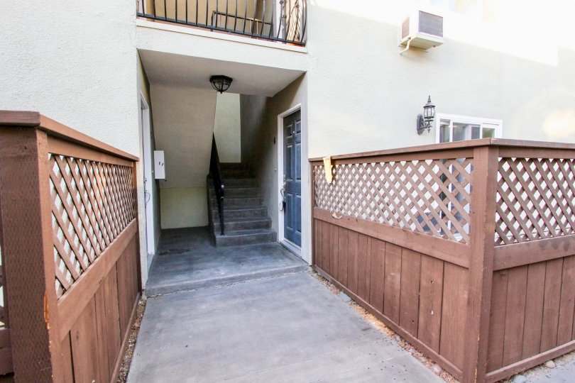 The entrance to the lower level stairwell of an apartment building in Heritage Park West in Clairemont Mesa, California.