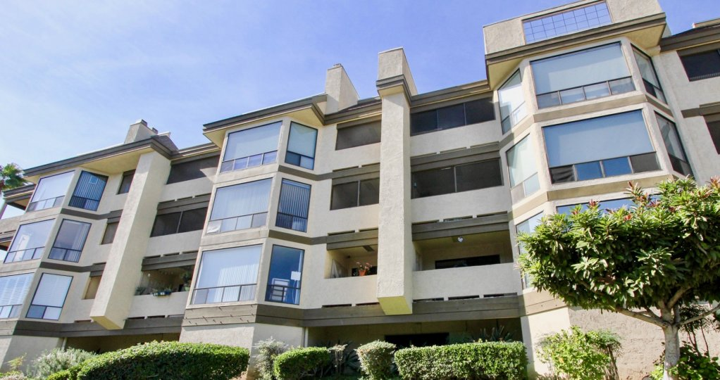 Four story residential building with built in parking at Mission Bay Ridge in Clairemont Mesa California