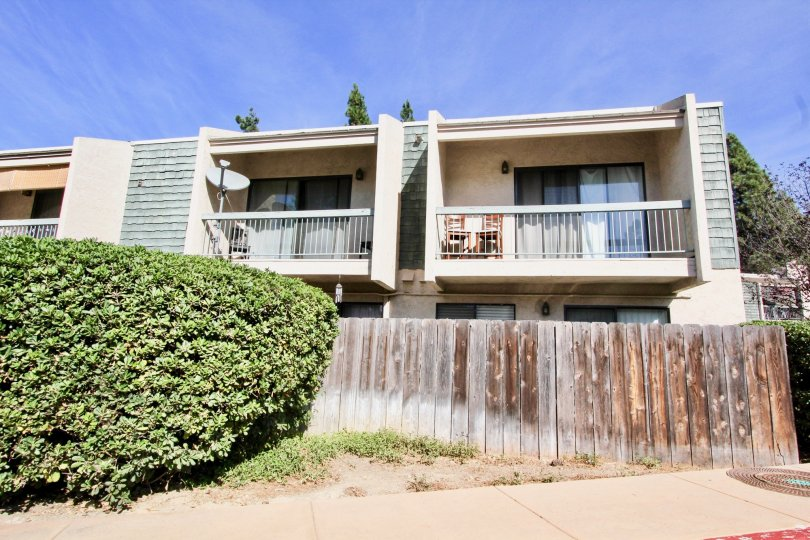 Multi-family complex with private back deck and yard with fence on bottom level in Clairemont Mesa, California