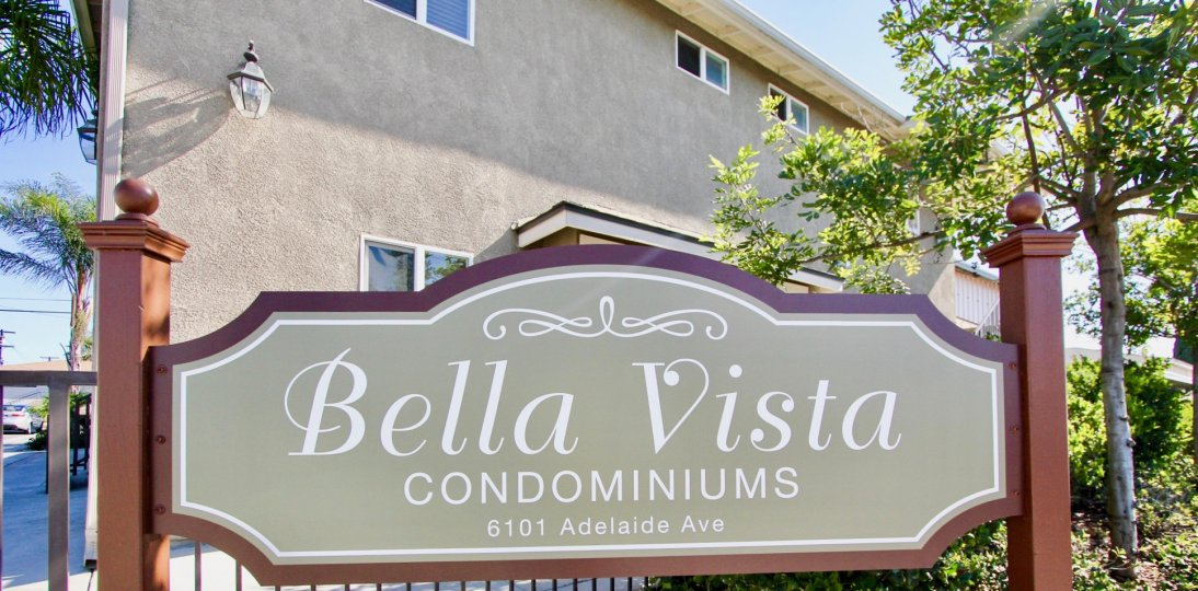 the Bella Vista with name board on the front entrance and tall trees around