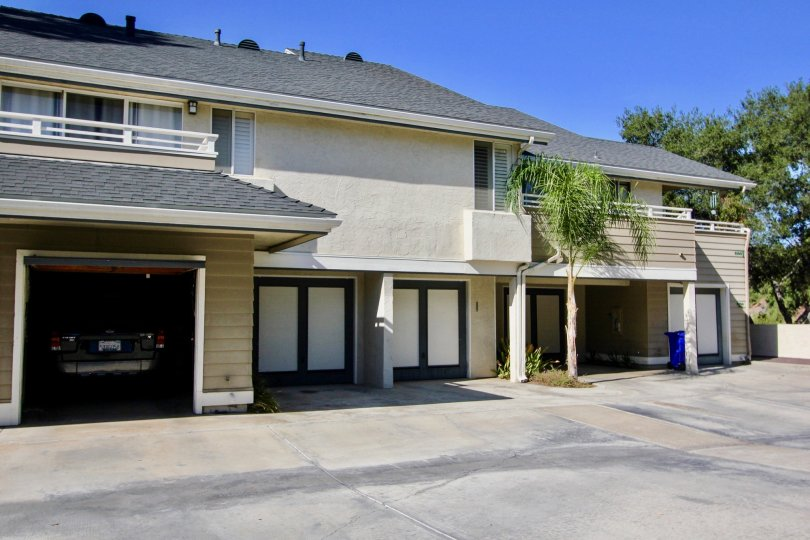 Two story housing unit with built in garages at Canyon Trails in College Area California