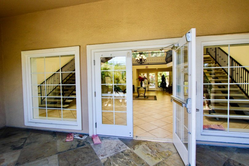 Large white doorway entrance at Carriage House in College Area California