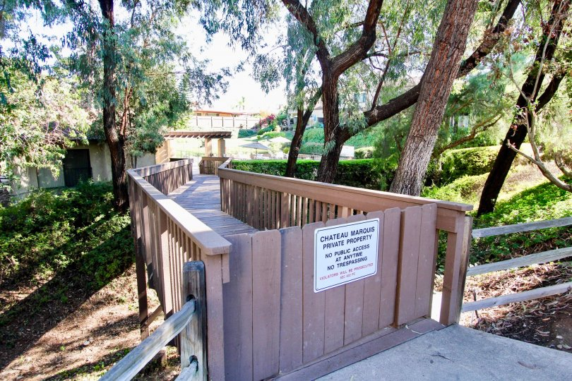Wooden boardwalk leading up to residential area at Chateau Marquis in College Area California