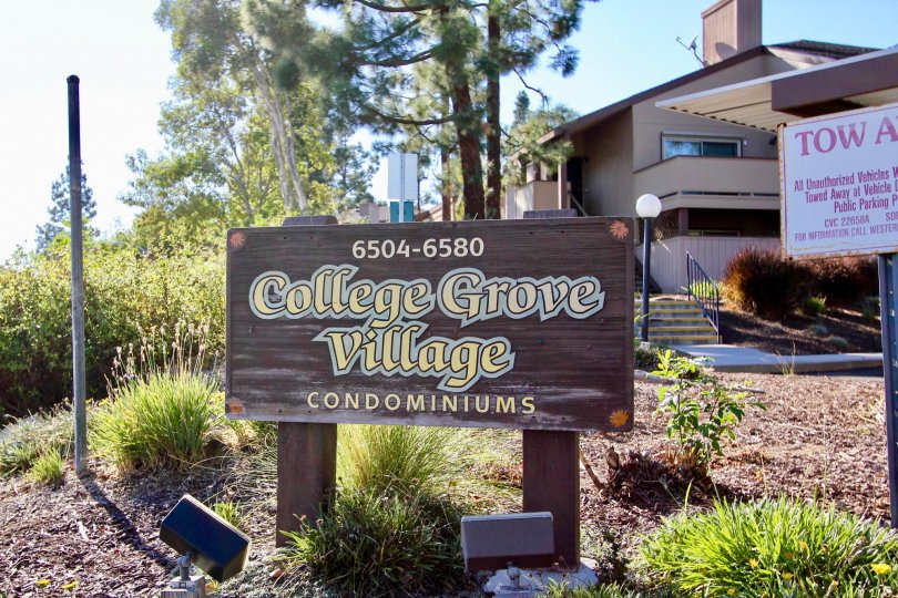An image of the College Grove Village Condominium sign and building.