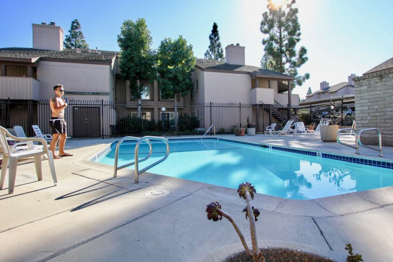 College Grove Village  , College Area. California, swimming pool,, man