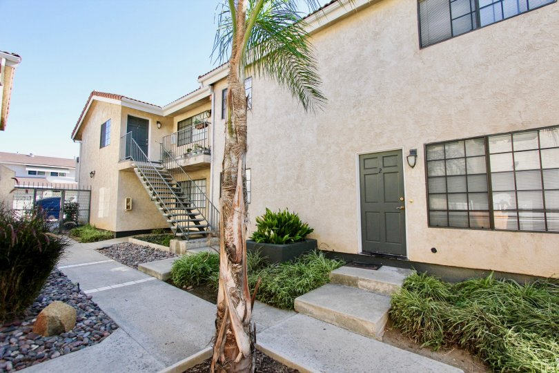 Two story townhomes with walkway at Isabella Park in College Area California