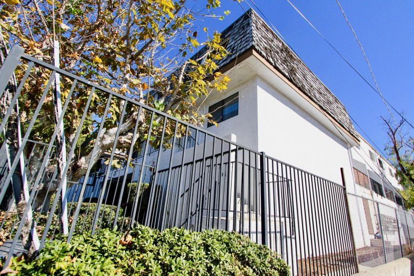 White fenced in unit located within Mediterranean Villas of College Area, California