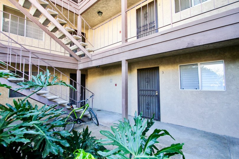rear doors and stairs of Menlo Ave Condos in College Area California