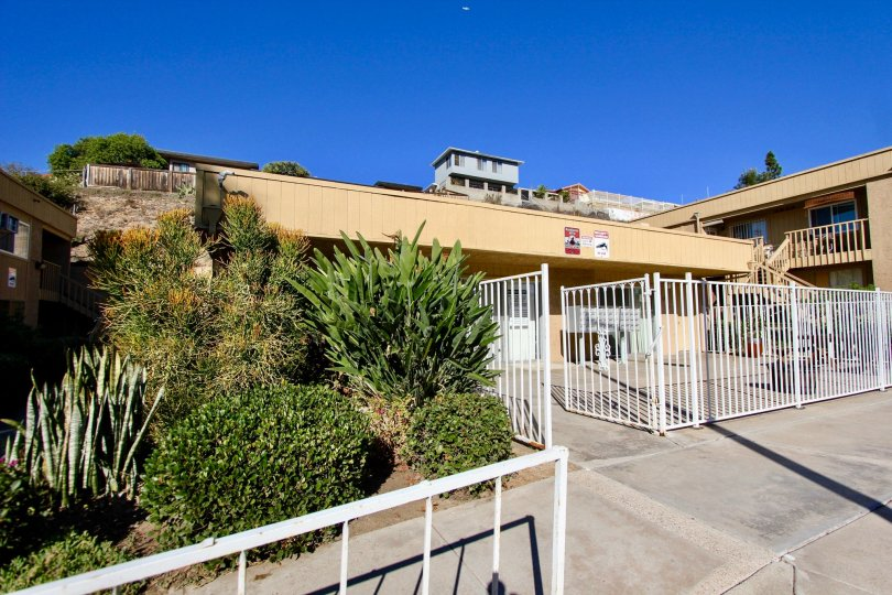 Security entrance surrounded Residential units at Mesa Greens in College Area California