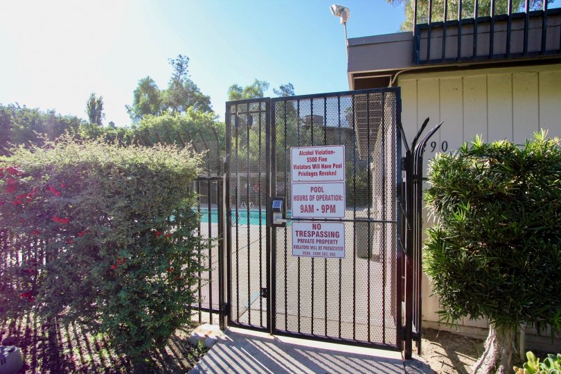 Security gate entrance to pool area at Montezuma Townhomes in College Area California