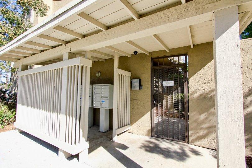 Security gate entrance near mailboxes at Presidio Park in College Area California