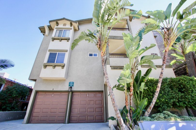 Off white 3 story unit with 2 separate garages located in Summit Place of College Area, California