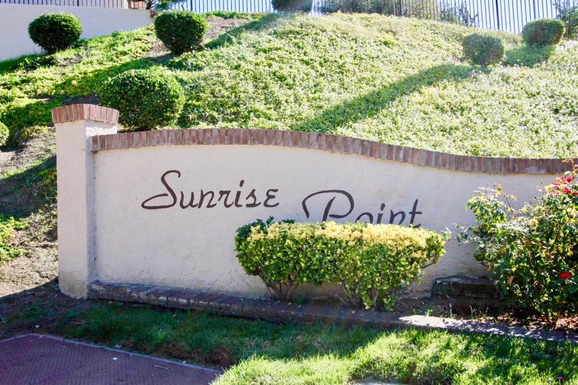 The Sunrise Point with name board at the entrance and lush green grass around